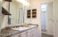 Updated with concrete overlay countertops, new lighting, accent shelves, sinks, faucets and hardware.