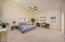 Vaulted ceilings, neutral carpet and ceiling fan in the master bedroom. Views of the Catalina Mountains from the window