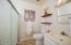 Pocket door to second vanity in and shower in the master bathroom