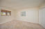 Located off the kitchen is the 4th bedroom with adjacent full bath. Window to the backyard
