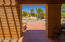 Covered patio with view of the Catalina Mountains from the front door