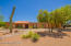 Low care front yard with decorative gravel and desert plantings.