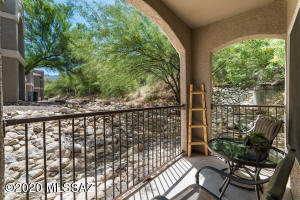 Privacy abounds from rear patio that looks to open space, with mountain views..