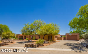Welcome Home to this solid slump block home situated on a .55 acre elevated lot in Sabino Vista Hills.
