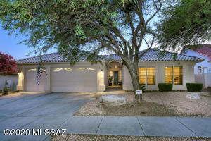 Classic Tucson with tile roof and 3 car garage