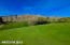 18 hole, par 71 golf course winds its way through the Sonoran Desert Foothills