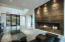Stunning metal angular gas fireplace with black glass, 27' ceilings