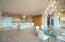 Custom designed cable lighting above dining, stunning kitchen.