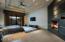 Stunning Master Suite; Corner fireplace. His & hers custom cherrywood closets & skylights.