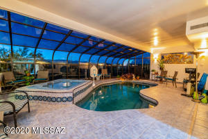 Enclosed pool room with space for exercise exercise equipment. Access from an room office and master as well as back north facing patio.