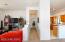 Hallway to master bedroom and laundry and garage entrance. Split bedroom floorplan.