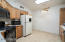 Kitchen with gas range, refrigerator with icemaker