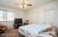 Master bedroom with rolling shutters