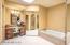 Primp here at the vanity, walk in mirrored closet plus soaking tub