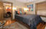 Bedrooms feature upgraded lighting and original hardwood floors