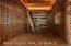 Montana sandstone plank flooring and copper tile ceiling.