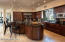 Huge center island with fractured glass breakfast bar