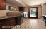 Spacious laundry room with utility sink and storage.