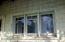 Redwood shingles, traditional trim of the windows