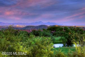 Golf course, lake & twinkling city lights