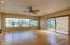 Large office or Bonus room has sliding door with 3 panes of glass and 3 large fixed windows