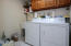 Nicely sized laundry room with utility sink and storage