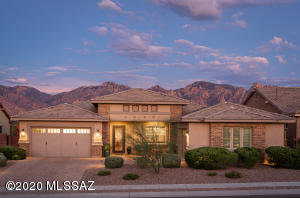 Incredible curb appeal with Catalina Mountains offering the perfect background.