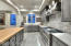 Chef's kitchen w/custom upgrades & gleaming wood counter