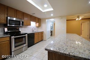 Beautifully updated kitchen with new Granite, new back splash, new sink and faucet