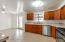 Remodeled kitchen with marble tile counter tops, stainless appliances and dining area.