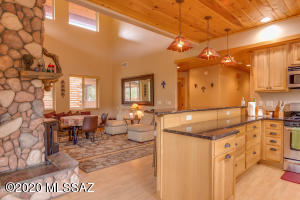 Inviting open floor plan allows conversation with guests while preparing meals.