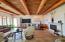 Living room with saguaro rib and vega beam ceilings.