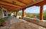 Incredible views from huge covered patio with tongue and groove ceiling and vega beams.