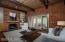 Fireplace, Sahuaro rib ceiling make this a cozy get-away space. Doors to rear patio.