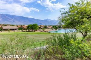 Backyard view of golf, mountains and lake.