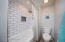 Subway tile tub/shower in the guest bath