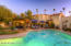 Resort-like back yard with privacy walls, sparkling pool, brick paver entertaining areas, ez care yard & outdoor dining.