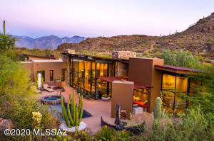 Private Retreat by award winning architect Michael Franks on 9 acres in prestigious Saguaro Ranch w/one -of-a-kind entry through mountain tunnel w/24-hr manned gate