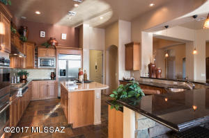 Gourmet kitchen features granite counters, alder cabinetry w/pull outs, GE Monogram stainless appliances, Gas range, double oven & onyx topped island w/prep sink.