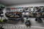 Within the garage there is a storage closet - and all the custom hanging racks convey with the home !