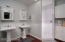 Double pedestal sinks and walk in tile shower.