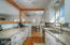 Light and bright with white cabinets, granite counters and stainless appliances.
