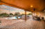 covered patio with ceiling fans and roller shades