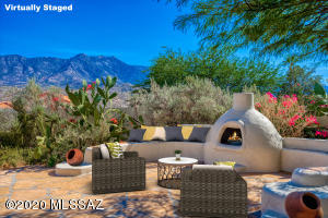 Virtually staged Kiva fireplace and expansive Patio.