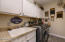 Large laundry with cabinets and sink