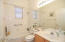 Nice guest bath with natural light.