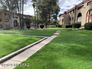 This grassy tree-lined courtyard is just outside the unit.