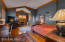 Owner's Suite with Gas Fireplace and Wood Flooring