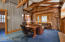 Great Room in Guest Quarters with Gas Fireplace and Exposed Beams