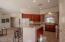 Kitchen boasts abundance of cabinets, granite counters, pantry, breakfast bar & island area